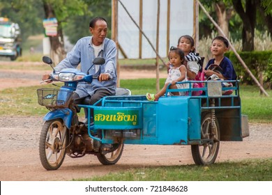 Hnong Main Ngam, Thailand - November 16, 2012: Grandpa collects the children from  school.in a motorcycle combination in rural Thailand.