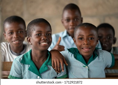 Ho, Asogli / Ghana - September 15, 2018: Students in a rural school in Ghana, West Africa, smile for a picture.