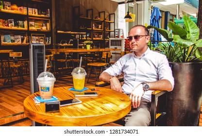 Ho Chi Min City  / Vietnam - 06.21.2016 - Traveler drinking a tea in Vietnam