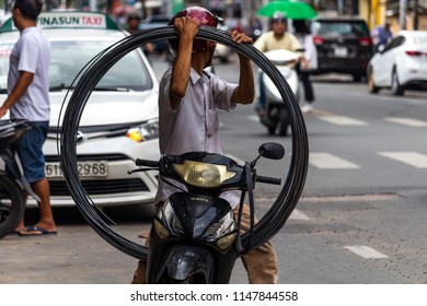 Ho Chi Minh City, Asia - May 11, 2018: Local man transporting a big item on his motorbike