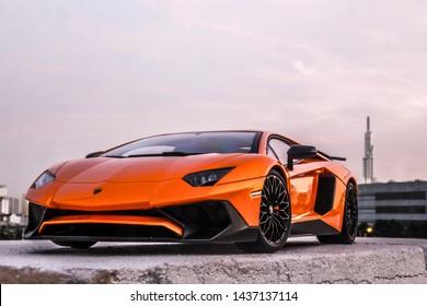 Ho Chi Minh City - January 2019: Lamborghini Aventador SV parked on a yard with Landmark 81 tower on background