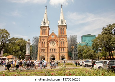 Ho Chi Minh City - March 9, 2019:  Tourists outside Notre Dame Cathedral in Ho Chi Minh City, or Saigon, Vietnam.