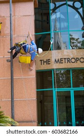 Ho Chi Minh City March 12 2017, The Metropolitan.Workers washing windows of the modern skyscraper building