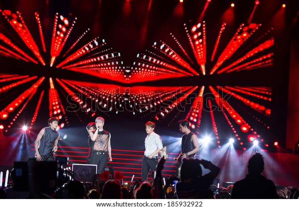 Ho Chi Minh City- March 22: Nickhun, Chang Sung, Woo Young, Jun Ho and Jun. K  (2PM band) dance and sing on stage at the Human Culture Equilibrium Concert Korea Festival in Viet Nam on March 22, 2014.