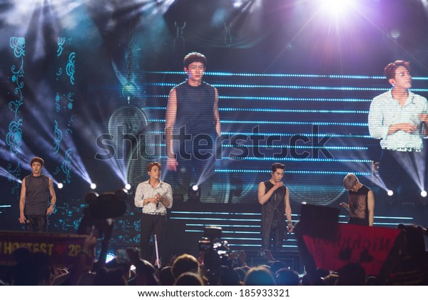 Ho Chi Minh City - March 22: Nickhun, Chang Sung, Woo Young, Jun Ho and Jun. K (2PM band) dance and sing on stage at the Human Culture Equilibrium Concert Korea Festival in Viet Nam on March 22, 2014.
