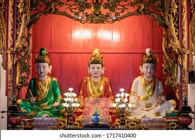 Ho Chi Minh city, Saigon, Vietnam; February 2020: Altar with three statues of spirits deities in red, green, white , gold inside the pagoda Vĩnh Nghiêm in the city centre of Saigon (Ho Chi Minh)