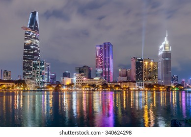 HO CHI MINH CITY, SAIGON/VIETNAM - CIRCA AUGUST 2015: Lights of Saigon downtown skyline are reflected in the river