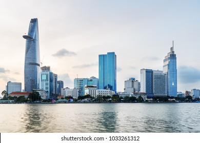 Ho Chi Minh City skyline and the Saigon River in Vietnam. Amazing evening view of skyscraper and other modern buildings at downtown. Beautiful cityscape.