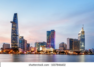 Ho Chi Minh City skyline and the Saigon River at sunset. Amazing colorful view of skyscraper and other modern buildings at downtown. Ho Chi Minh City is a popular tourist destination of Vietnam.