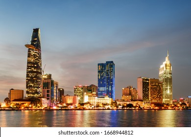 Ho Chi Minh City skyline and the Saigon River at sunset. Scenic colorful view of skyscraper and other modern buildings at downtown. Ho Chi Minh City is a popular tourist destination of Vietnam.