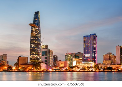 Ho Chi Minh City skyline and the Saigon River at sunset. Colorful view of skyscraper and other modern buildings at downtown. Ho Chi Minh City is a popular tourist destination of Vietnam.
