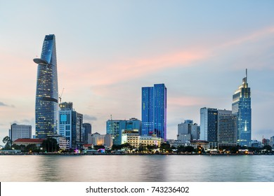 Ho Chi Minh City skyline and the Saigon River at sunset. Beautiful view of skyscraper and other modern buildings at downtown. Ho Chi Minh City is a popular tourist destination of Vietnam.