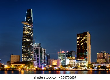 Ho Chi Minh City skyline and the Saigon River. Beautiful night view of skyscraper and other modern buildings at downtown. Ho Chi Minh City is a popular tourist destination of Vietnam.