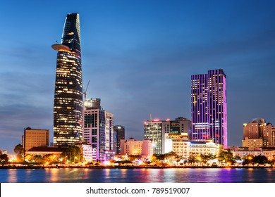 Ho Chi Minh City skyline and the Saigon River. Colorful night view of skyscraper and other modern buildings at downtown. Ho Chi Minh City is a popular tourist destination of Vietnam. Scenic cityscape.