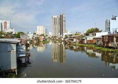 Ho Chi Minh City slums by river, Saigon, Vietnam