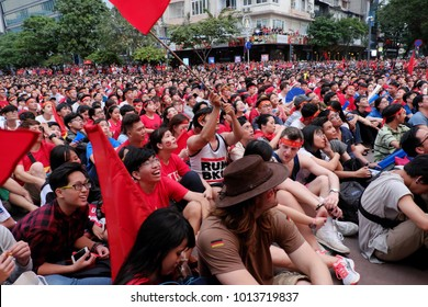 HO CHI MINH CITY, VIET NAM- JAN 27, 2018:  Exiting atmosphere of Vietnamese football fans when watch the AFC U23 final match from outdoor Tv screen at Nguyen Hue walking street