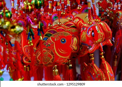 HO CHI MINH CITY, VIET NAM- JAN 25, 2019: Close up of vibrant red ornaments for Tet at decoration shop on China town, Cho Lon, a market place to decor for Lunar New Year, Vietnam