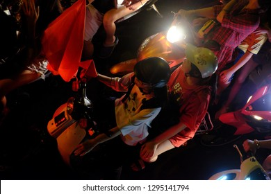 HO CHI MINH CITY, VIET NAM- DEC 15, 2018: Crowded Vietnamese street at night, young people ride motorbike stuck in traffic jam, motorcycles in slow moving at big city, amazing traffic from high view