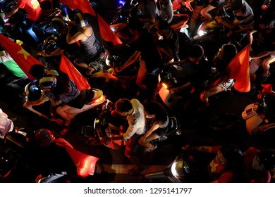 HO CHI MINH CITY, VIET NAM- DEC 15, 2018: Crowded Vietnamese street at night, young people ride motorbikes stuck in traffic jam, motorcycles in slow moving at big city, amazing traffic from high view