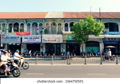 HO CHI MINH CITY, VIET NAM- MARCH 27, 2019: Row of ancient house along street at China town, group of townhouse with old architect with window and door in arch style,
