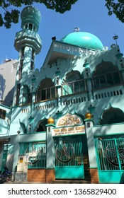HO CHI MINH CITY, VIET NAM- MARCH 27, 2019: Front view of Islam mosque in cyan color on day, cathedral with muslim architecture from bottom view at Vietnam