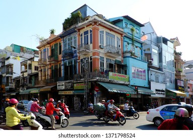HO CHI MINH CITY, VIET NAM- MARCH 27, 2019: Group of colorful old house at crossroad on day, facade of townhouse in china town with wooden window, door in old architecture of Chinese live in Vietnam