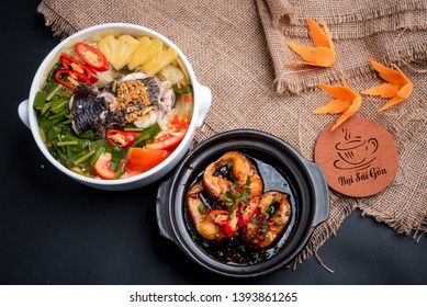 Ho Chi Minh city, Viet Nam 10 April 2019: Vietnamese traditional food: rice, sour fish soup: made with snakehead fish and Braised snakehead fish