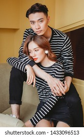 Ho Chi Minh city, Viet Nam - March 13, 2019 : The couple poses on the  yellow background , cute , fashion