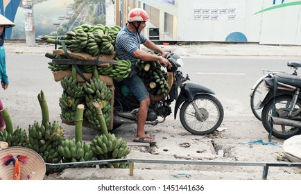 HO CHI MINH CITY, VIET NAM- JULY 06, 2019: Vietnamese man transport many banana bunch by motorbike on day, bananas is popular agriculture product at Vietnam