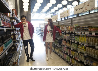 Ho Chi Minh city, Viet Nam -June 26, 2016 : Asian couple are walking shopping in supermarkets, wearing coats, fashion