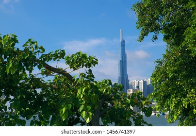 HO CHI MINH CITY, VIET NAM- MAY 20, 2019: Landscape of Landmark 81 view from Thanh Da at morning with green leaves foreground under blue sky, impression with tallest building in real estate, Vietnam