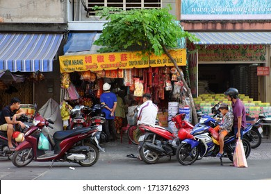 HO CHI MINH CITY, VIET NAM- JAN 5, 2020: Vietnamese buy votive paper as offerings to worship, traditional cultural of Vietnamese lifestyle, shop under tree with branch of tree on roof on day