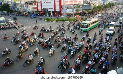 HO CHI MINH CITY, VIET NAM- APRIL 4: Circulation by private vehicle at Asia city, people transport by motorbike coming home in a row, crowded atmosphere after working day, Vietnam, April 18, 2014