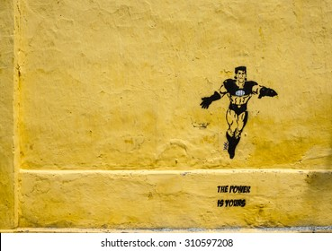 HO CHI MINH CITY, VIET NAM - OCT 17, 2014. A superman painted on the wall, colorful creative with nice shapes, street art of modern time in Saigon, Vietnam.