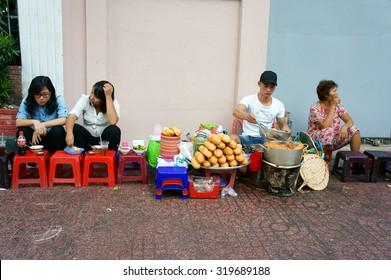 HO CHI MINH CITY, VIET NAM- DEC 17: Vietnamese street food, food vendor sale streetfood on pavement, this kind of eating very cheap, fast, can for snack or  meal of day, Saigon, Vietnam, Dec 17, 2104