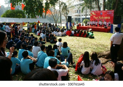 HO CHI MINH CITY, VIET NAM- FEB 9: Group of Asian highschool student in outdoor activity when join spring camp, crowd of teen girl, teen boy sitting and join music, Saigon, Vietnam, Feb 9, 2015