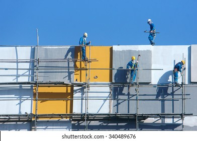 HO CHI MINH CITY, VIET NAM- NOV17: Group of Asian construction worker working on scraffold at apartment building site, Vietnamese man climbing, danger, unsafe for builder, Saigon, Vietnam, Nov17, 2015