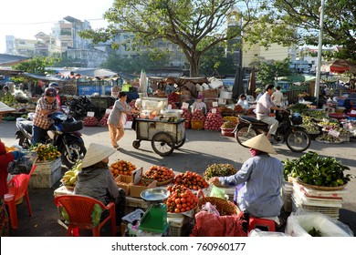 HO CHI MINH CITY, VIET NAM- NOV 21, 2017: Amazing scene of fruit market at Cho Lon, Vietnam in early morning, colorful fruit baskets show at open air market, crowded and busy street