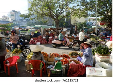 HO CHI MINH CITY, VIET NAM- NOV 21, 2017: Beautiful scene of fruit market at Cho Lon, Vietnam in early morning, colorful fruit baskets show at open air market, friendly saleswoman with smiling face