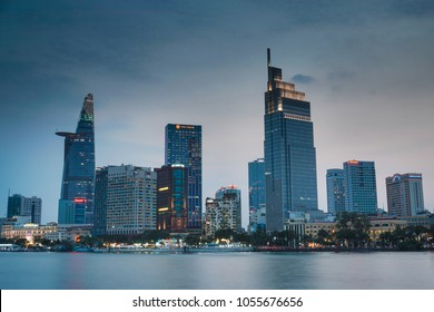Ho Chi Minh city, Vietnam - March 11, 2018: Beautiful city scene before the sun went down along the Saigon river side with skyscrapers relect on smooth water