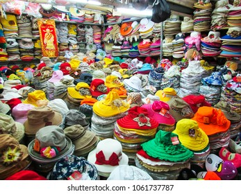 Ho Chi Minh City, Vietnam - December 14, 2013: colorful summer hats store in a local indoor market in Vietnam