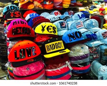 Ho Chi Minh City, Vietnam - December 15, 2013: colorful summer hats store in a local indoor market in Vietnam