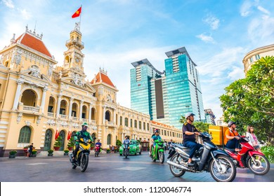 Ho Chi Minh City, Vietnam - April 30, 2018: Saigon City Hall, Vincom Center towers, colorful street traffic & tropical plants against the amazing blue sky. Saigon downtown with its famous landmarks.