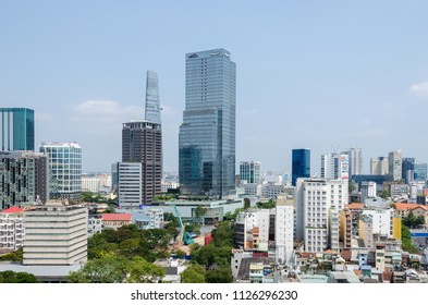 Ho Chi Minh City, Vietnam - 4 April, 2018: Ho Chi Minh City metropolis with its few remaining old buildings and new modern buildings of the hotels and Bitexco Financial Tower at the background
