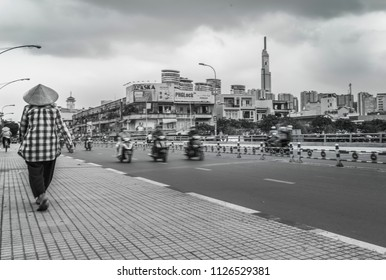 Ho Chi Minh City, Vietnam, June 2018 - Overcast day busy traffic on the bridge in black and white.