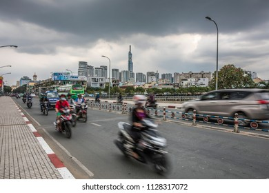 Ho Chi Minh City, Vietnam, June 2018 - Overcast day busy traffic on the bridge in the city.
