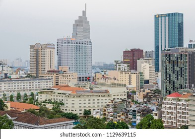 Ho Chi Minh City, Vietnam - 4 April, 2018: View of the fast growing and built up center of Saigon with the Opera View building owned by Artex Saigon with hotels Caravelle and Sheraton at dawn