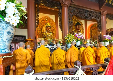 Ho Chi Minh City, Vietnam - May 29, 2018: Buddhist monk praying Buddha in Buddha's birthday celebrations being held in temple morning as a ritual of traditional culture in Ho Chi Minh city, Vietnam