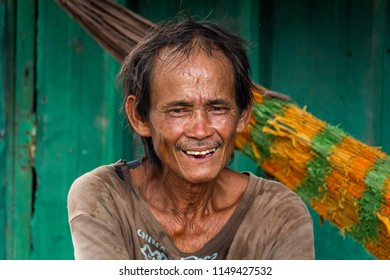 Ho Chi Minh City, Vietnam - May 14, 2018: Portrait of a man living in a poor neighborgood of Ho Chi Minh City. Credit: Dino Geromella/Shutterstock