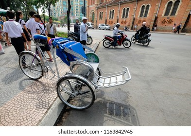Ho Chi Minh City, Vietnam -AUG 2, 2018:Cyclos on street waiting guests. Royalty high quality free stock image of cyclo bicycle. Cyclo is the preferred means of transportation for tourist